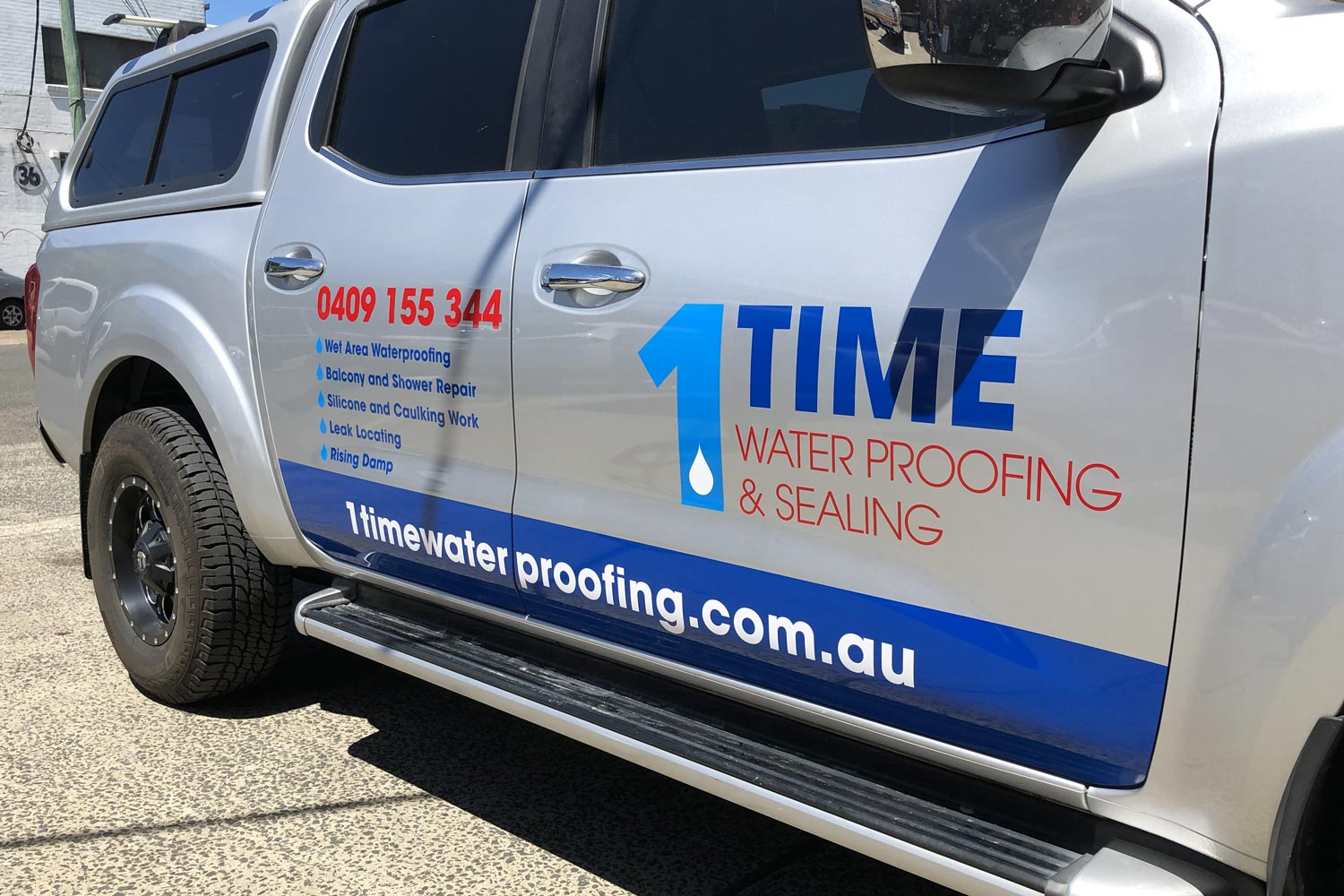 1Time Waterproofing Nissan right-side with signage