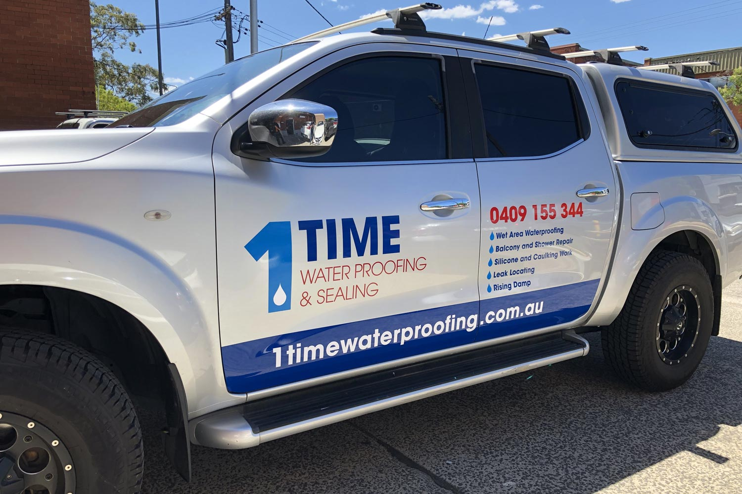 1Time Waterproofing Nissan left-side with signage